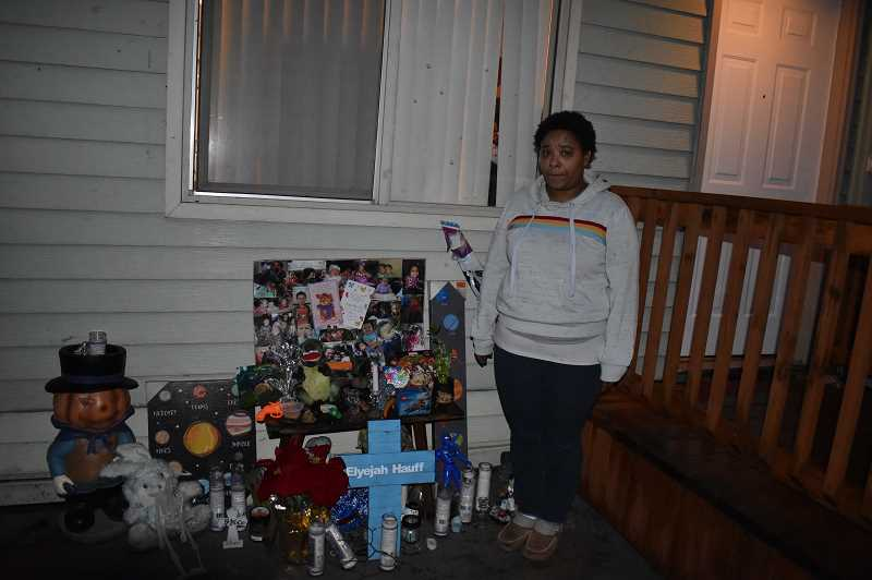 PMG PHOTO: RAYMOND RENDLEMAN - Elyejah Hauff's mother Phillesha Bradford stands next to his memorial that family members constructed in front of their home in Oregon City.