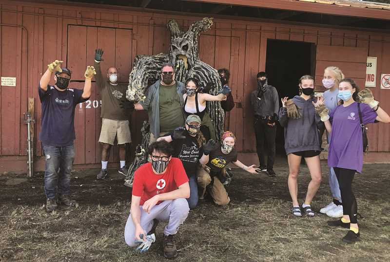 COURTESY PHOTO: CREATURES OF THE NIGHT - The build crew from Creatures of the Night during a break as they prepare for another night of fun at the fairgrounds.