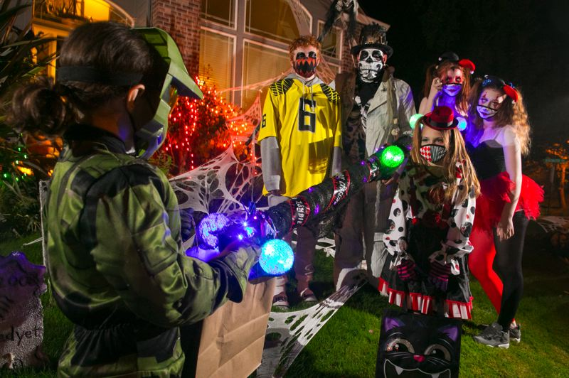 PMG PHOTO: JAIME VALDEZ - The Summers family, which goes all out for Halloween every year, is celebrating the holiday again this year but with COVID-19 precautions in place. From left: Maverick, 14, Jeremy, father, Skyla, 17, Kenzie, 18, and Leia, 9.