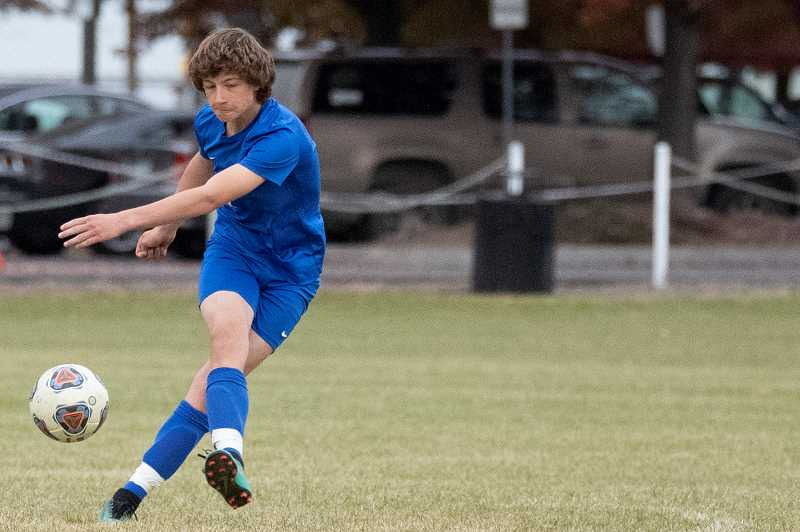 CENTRAL OREGONIAN - Cainen Smith boots the ball during the Cowboys' 2019 season last fall. The boys and girls soccer programs starts a short season this week.