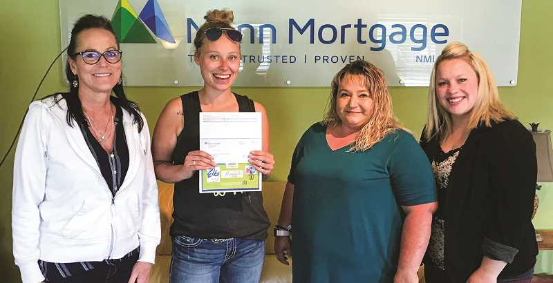 PHOTO SUBMITTED BY LISA HEVERN - Humane Society of the Ochocos was a donation recipient of the Your Vote Counts program during the second quarter of 2020. Pictured left to right are Kim Patterson of Mann Mortgage, Shawna West and Chanda Wallace with Humane Society of the Ochocos and Lacey Madden of Mann Mortgage.