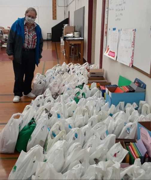 COURTESY PHOTO - Project Chair Jim Jaggers stands amid school supplies delivered by the Woodburn Christian Church to the Mari-Linn School Gym in Lyons on Oct. 23. Supplies were gathered by parishioners and donations of almost $600 were made to the project.