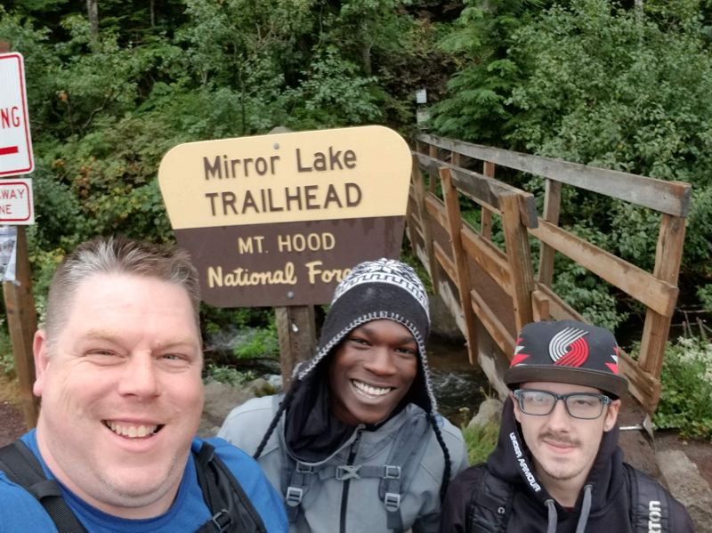 COURTESY OF SQUIRES PDX - Squires Executive Director and Founder Shanne Sowards poses for a photo during a hike outing with Squires members Kwame Assuman (center) and Ryan Heitzenrate (left).