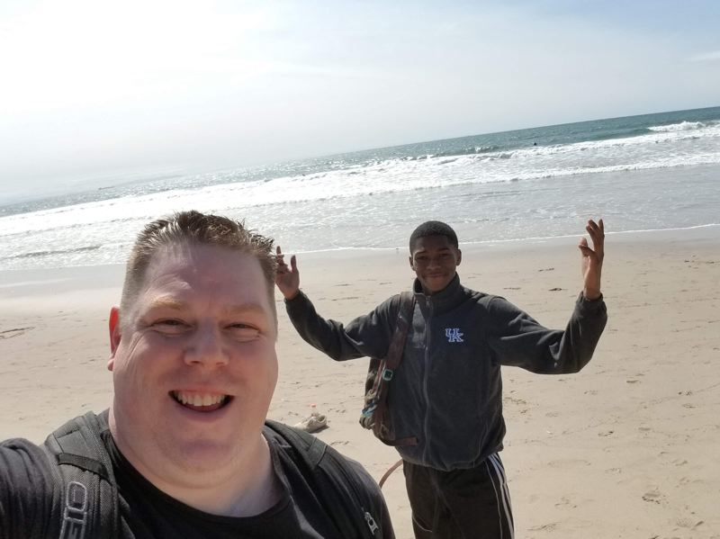 COURTESY OF SQUIRES PDX - Shanne Sowards and LaShawn Barrow (right) on a beach trip organized by Squires PDX, a local nonprofit aimed at providing a support network for teen father and helping connect them to resources.