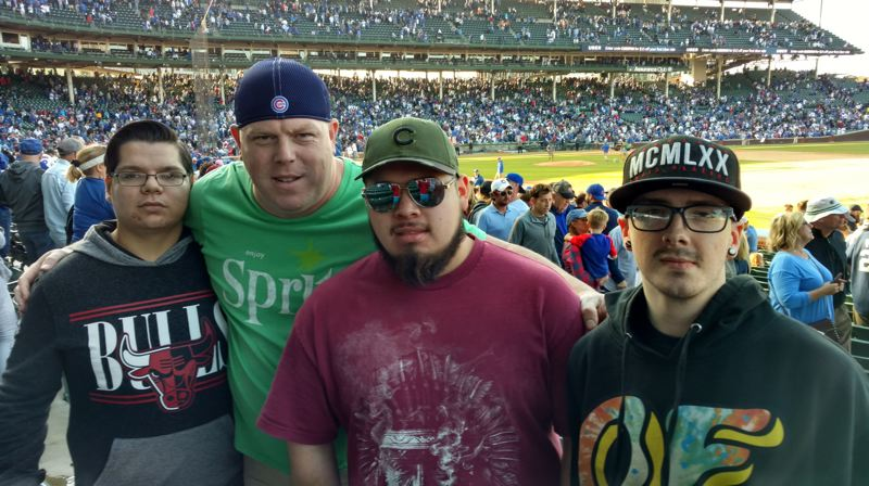 COURTESY OF SQUIRES PDX - Left to right: Russell Ball, Shanne Sowards, Brian Santana and Ryan Heitzenrate pose for a photo at a Chicago Cubs game during a trip organized by Sowards through his nonprofit Squires PDX.