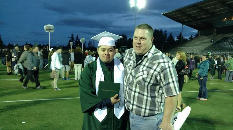COURTESY SQUIRES PDX - Brian Santana (left) poses with his mentor Shanne Sowards following his graduation ceremony at Tigard High School.