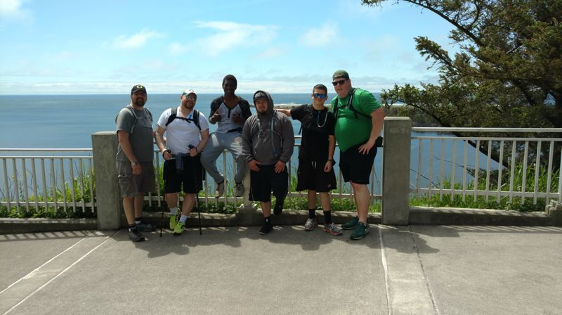 COURTESY OF SQUIRES PDX - From left: Mike Ward, Dean Cramer, Kwame Assuman, Brian Santana,  Angel Guerrero and Shanne Sowards on an outing to Cape Disappointment in Pacific County, Washington.