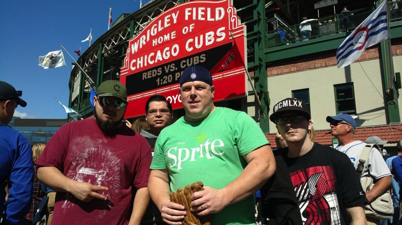 COURTESY OF SQUIRES PDX - From left: Brian Santana, Russell Ball, Shanne Sowards and Ryan Heitzenrate pose for a photo in front of Wrigley Field during a Squires PDX trip to Chicago.