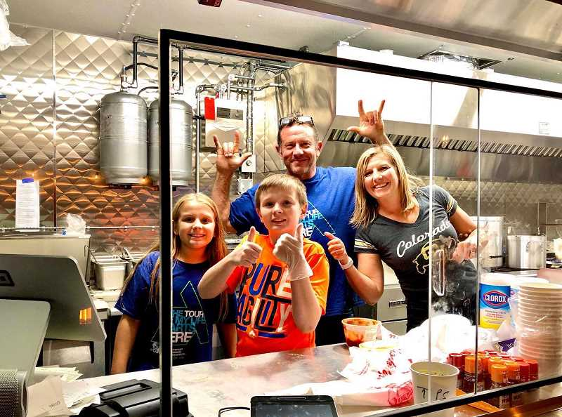 COURTESY PHOTO - Suzi Jewett and her husband Jason, with their two kids, Jacob and Sami, serve ramen from their Bamen Ramen foot truck located on 19th Avenue near Ash Street in Forest Grove.