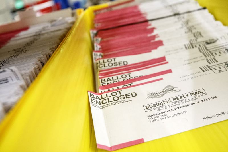 PMG PHOTO: JON HOUSE - General election ballots that have already been returned in Multnomah County.