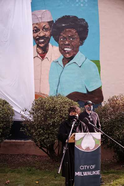 COURTESY PHOTO: HAMID SHIBATA BENNETT - Dorothy Hadley speaks at the Oct. 24 unveiling on the mural in her honor, with her husband, Hurtis, just behind her.