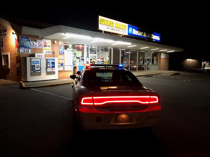 COURTESY PHOTO: CCSO - Clackamas County Sheriff's Office deputies arrive at Sunrise Market, the scene of an armed robbery, on Sunday, Oct. 25, after the suspect had fled.