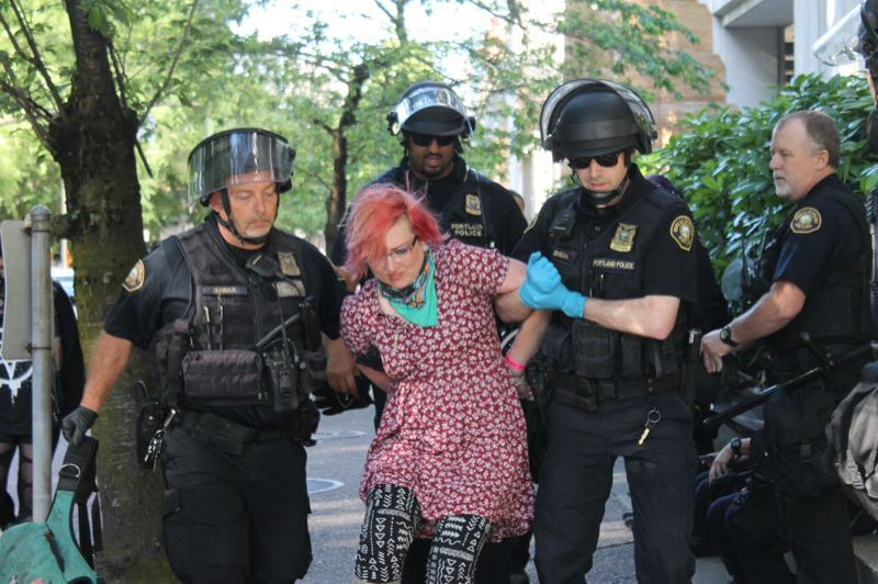 PMG FILE PHOTO - Police arrest a demonstrator during a protest.