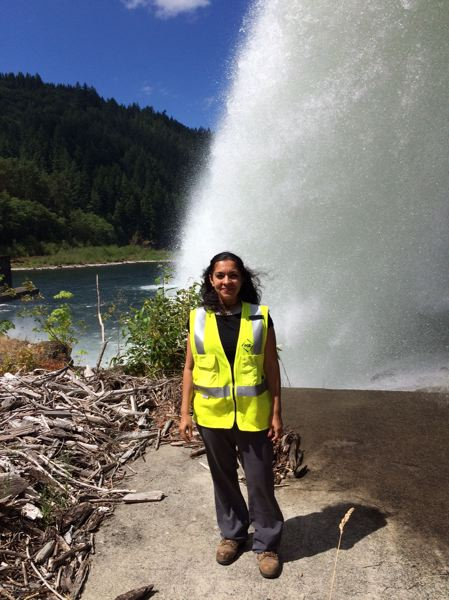 COURTESY PHOTO - Mini Sharma Ogle, an archaeologist at Portland General Electric, is pictured near a culturally significant site along the Clackamas River.