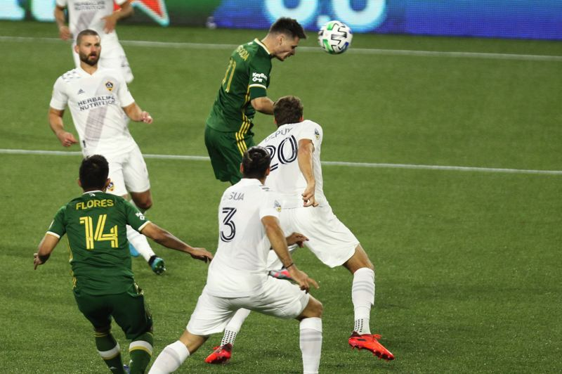 PMG PHOTO: JAIME VALDEZ - With this early header, the first of his two goals Wednesday, Timbers forward Jaroslaw Niezgoda gave Portland a quick lead its 5-2 win over the LA Galaxy.