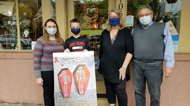 COURTESY PHOTO - World HeARTS Fair Trade employee Samantha Dusek joins middle school student Zachary Baker and owners Robin and Kurt May.