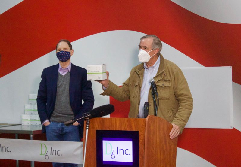 PMG PHOTO: CHRISTOPHER KEIZUR - Sens. Jeff Merkley and Ron Wyden spoke during the opening of Greshams D6 Inc.s new medical production facility.