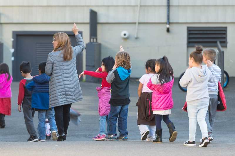 PMG FILE PHOTO - Students return to their classroom after recess at Reedville Elementary in 2017 in Beaverton. Oregon announced revised school reopening guidelines that will make it easier for students to return to classrooms amid COVID-19.