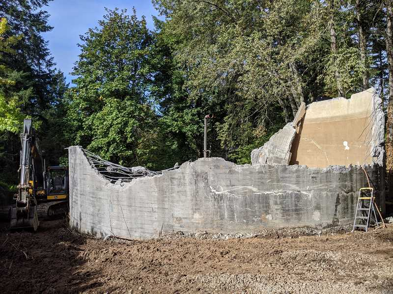 PMG PHOTO: COURTNEY VAUGHN - Demolition of the decommissioned Freeman water tank was underway Friday, Oct. 16. The tank is slated to be torn down to make way for new homes on the lot.