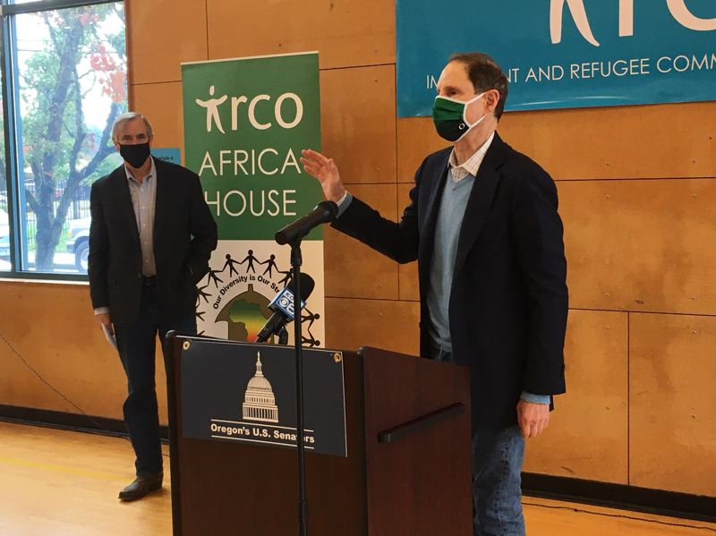 PMG PHOTO: PETER WONG - U.S. Sen. Ron Wyden, D-Ore., makes a point about the election as U.S. Sen. Jeff Merkley, D-Ore., awaits his turn to comment. They did so Friday, Oct. 30, in Portland after an event sponsored by the Immigrant and Refugee Community Organization.