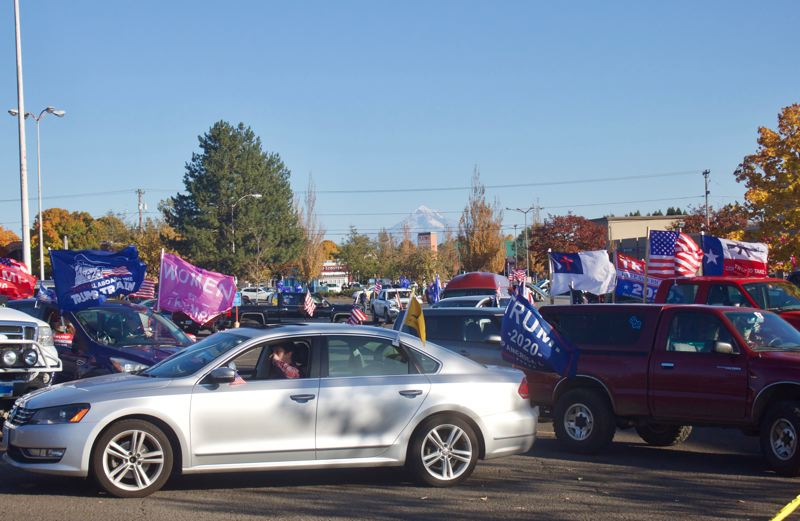 PMG PHOTO: CHRISTOPHER KEIZUR - Hundreds of President Donald Trump supporters rallied in Gresham Sunday afternoon, Nov. 1.