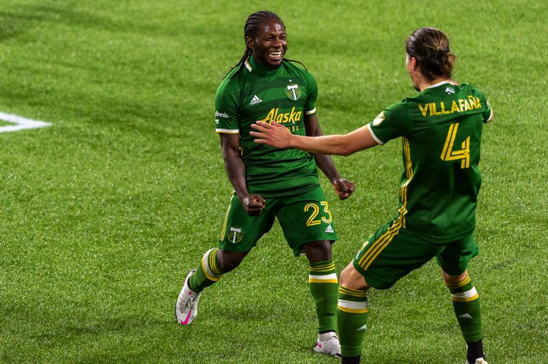 PMG PHOTO: DIEGO DIAZ - Yimmi Chara (23) and Jorge Villafana celebrate after teaming up for the Chara goal that produced a 1-0 Timbers win over the Vancouver Whitecaps on Sunday, Nov. 1, at Providence Park.
