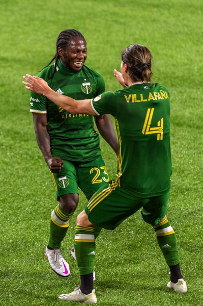 PMG PHOTO: DIEGO G. DIAZ - Yimmi Chara (23) and Jorge Villafana celebrate after combining for Chara's goal in a 1-0 win over the Vancouver Whitecaps on Sunday, Nov. 1.