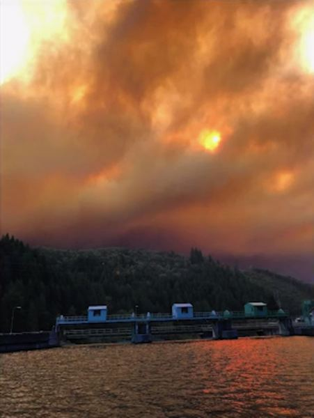 COURTESY PHOTO - Smoke from the Riverside Fire can be seen above Portland General Electric facilities along the Clackamas River.