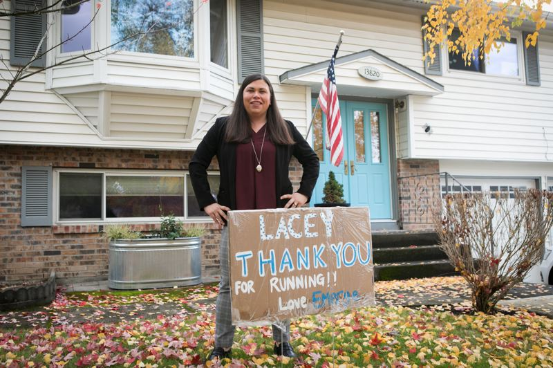 PMG PHOTO: JAIME VALDEZ - Mayor-elect Lacey Beaty stands in her front yard in Beaverton on Wednesday, Nov. 4, with a supporter's sign.