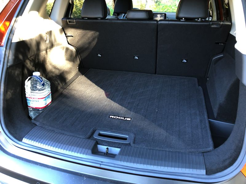 PMG PHOTO: JEFF ZURSCHMEIDE - Nissan has also worked on the Rogue's utility by enlarging the rear side bins enough to hold a standard gallon jug of milk or water, and the door pockets are sized for 32-ounce bottles.