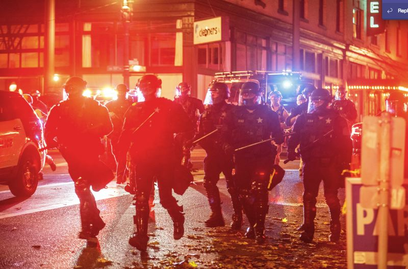 PMG PHOTO: JONATHAN HOUSE - Unified Command police responded to a riot on Nov. 4 in downtown Portland.