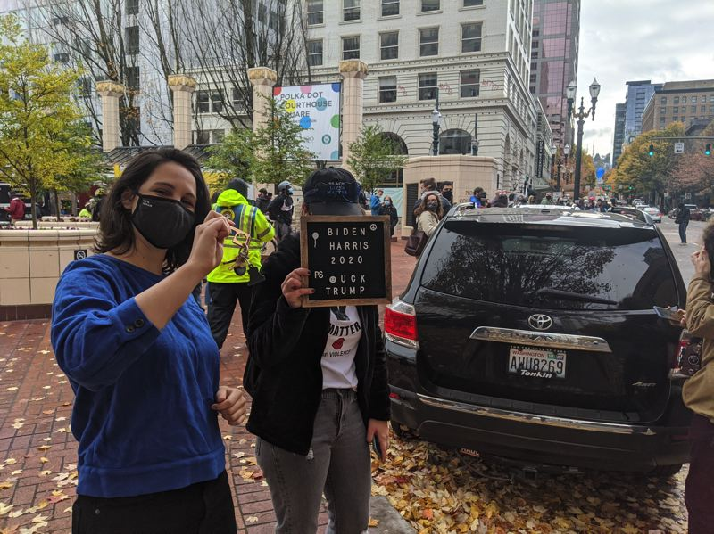 PAMPLIN MEDIA GROUP: JOSEPH GALLIVAN  - Amy (shaking keys) and Rachel, who declined to give their last names, followed the sound of car horns and walked to Pioneer Courthouse Square on Saturday morning, Nov 7 2020, to celebrate Joe Biden's election victory over Donald Trump.