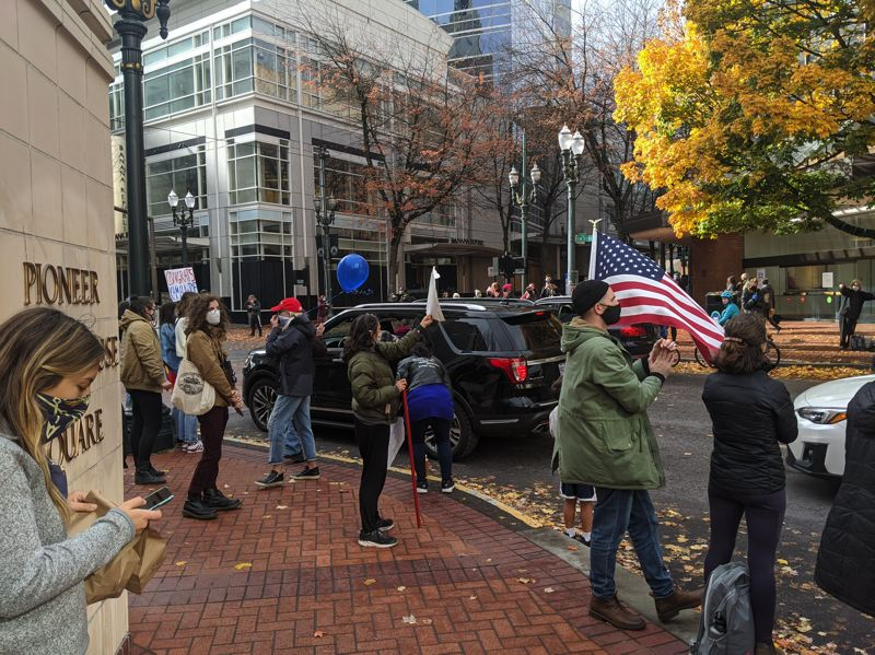 PAMPLIN MEDIA GROUP: JOSEPH GALLIVAN  - Near Pioneer Courthouse Square US flags were flown Saturday morning, Nov. 7, 2020, as Portlanders celebrated Biden's presidential election victory.