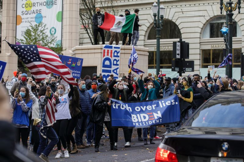 PMG PHOTO: JONATHAN HOUSE - People celebrate in downtown Portland after Joe Biden was declared the next president of the United States.