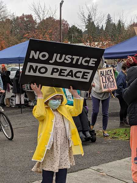 PMG PHOTO: COURTNEY VAUGHN - A child holds a sign during a 'Break the White Silence' youth-led event in support of Black Lives Matter Saturday, Nov. 7.