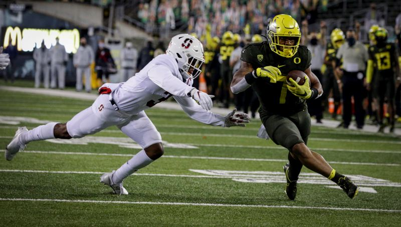 COURTESY PHOTO: ANDY NELSON/EUGENE REGISTER-GUARD - Oregon's CJ Verdell ran for 105 yards and a touchdown as the Ducks opened Pac-12 play Saturday by beating Stanford 35-14.