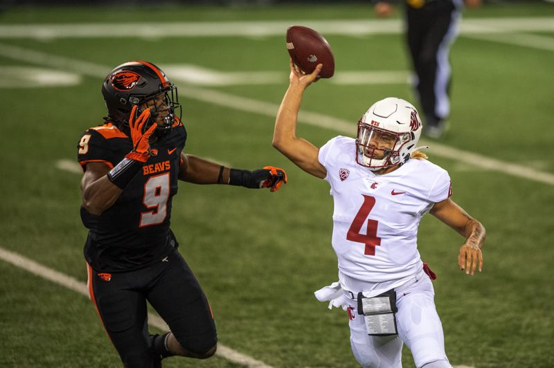 COURTESY PHOTO: KARL MAASDAM/OSU - Hamilcar Rashed Jr. and Oregon State defenders had a tough time slowing down Washington State freshman QB Jayden de Laura in a 38-28 loss Saturday.