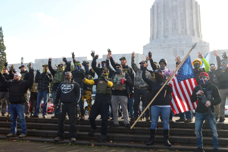 PMG PHOTO: ZANE SPARLING - Members of the right-wing group known as the Proud Boys made the 'OK' hand symbol, which has become a symbol of the group's violent, rightwing rhetoric, during a 'Stop The Steal' rally at the State Capitol in Salem on Saturday, Nov. 7.