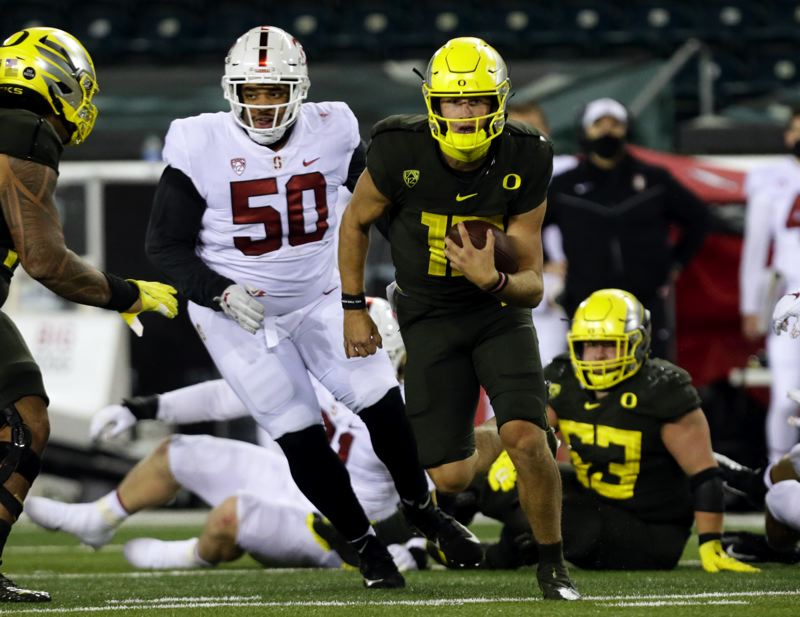 COURTESY PHOTO: ANDY NELSON/EUGENE REGISTER-GUARD - Oregon quarterback Tyler Shough made some big runs in Oregon's 35-14 win over Stanford.
