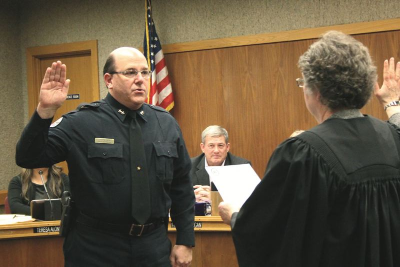 PMG FILE PHOTO - Jim Ferraris was sworn in as Woodburn's new police chief in December 2015.