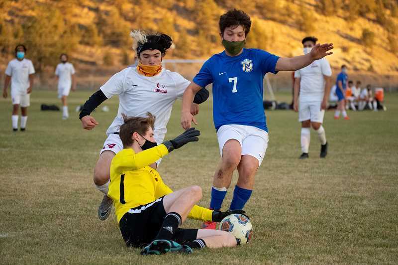 LON AUSTIN - Kevin Arroyo, 7, scored three goals for Crook County during the Cowboys' 8-4 win over Redmond Nov. 3. Later in the week, CCHS challenged a tough Madras squad but lost 5-1.