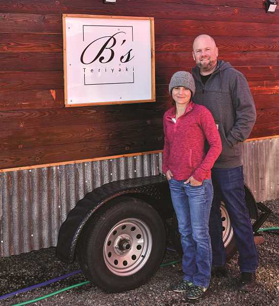 RAMONA MCCALLISTER - Ben and Lindsey Stewart pause for a photo in front of their food cart business, B's Teriyaki. The couple opened for business on Aug. 20, 2020, and are located in the Creekside Food Court, 1255 NE Third St., Prineville.