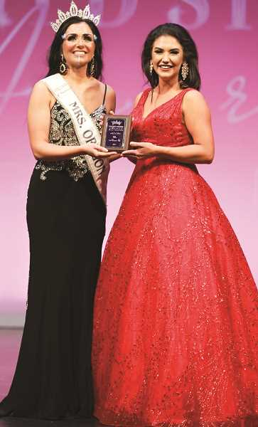 ATTRIBUTE TO BELIEVE PHOTOGRAPHY - Pictured left, Jordan Fink, Mrs. Lane County and Mrs. Oregon 2020 for the United States of America pageant Mrs. category, presents Kaley Blasdell with the First Runner up plaque on Oct. 23, 2020, during the weekend pageant conclusion.
