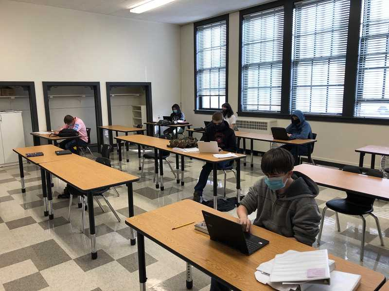 PHOTO COURTESY OF CROOK COUNTY SCHOOL DISTRICT  - Students at the Hybrid Learning Campus at Pioneer complete school work at the rebranded facility.