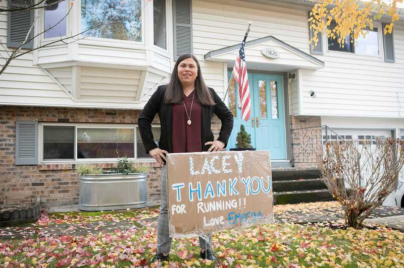 PMG PHOTO: JAIME VALDEZ - Mayor-elect Lacey Beaty stands in her front yard in Beaverton on Wednesday, Nov. 4, with a supporters sign.