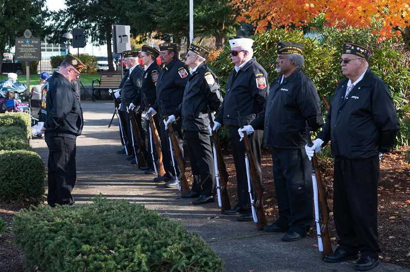 PMG FILE PHOTO - Members of Veterans of Foreign Wars Post 2666 stand with their rifles during a Veterans Day Ceremony at Veterans Memorial Park in Cornelius in 2019. This year, veterans will be honored by Washington County through a livestream event.