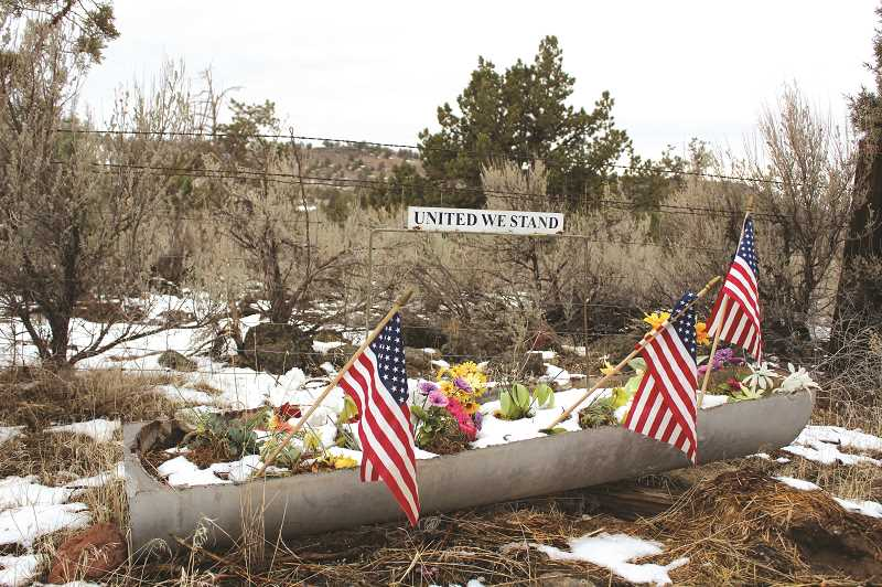 TONY AHERN/MADRAS PIONEER  - This patriotic planter, located along Quaale Road north of Madras, was a sight to behold on Sunday morning, and certainly puts forth an important, powerful message of unity following a rough and tumble political season.  The first snow of the season helped make the planter even more striking.