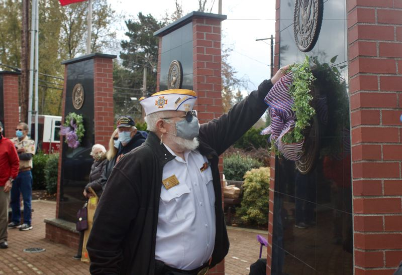 PMG PHOTO: CHRISTOPHER KEIZUR - Gresham Veteran Bob Dooms placed a wreath at the pylon honoring naval veterans during a ceremony Nov. 11.