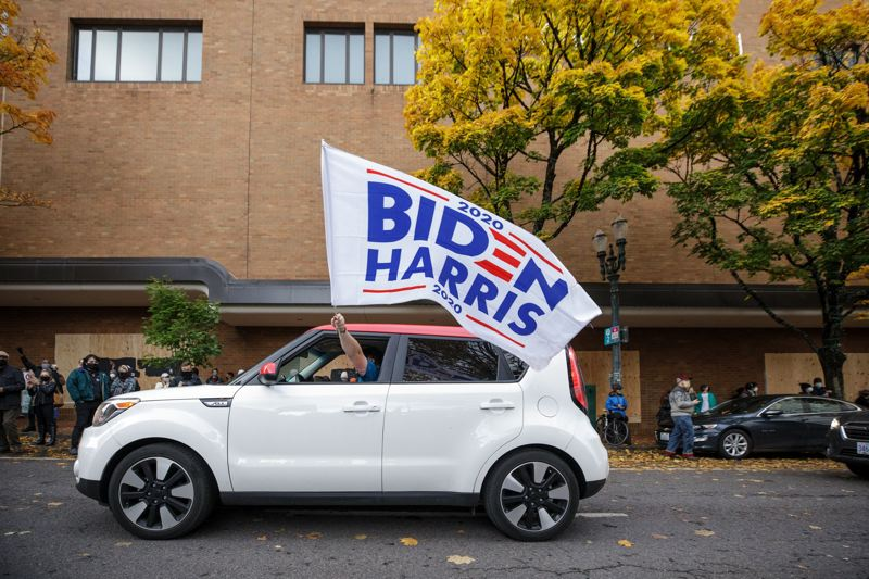 PMG PHOTO: JAIME VALDEZ - A car flies a Biden/Harris flag on the streets of Portland on Saturday, Nov. 7, after major news outlets declared the presidential election had been won by Joe Biden.