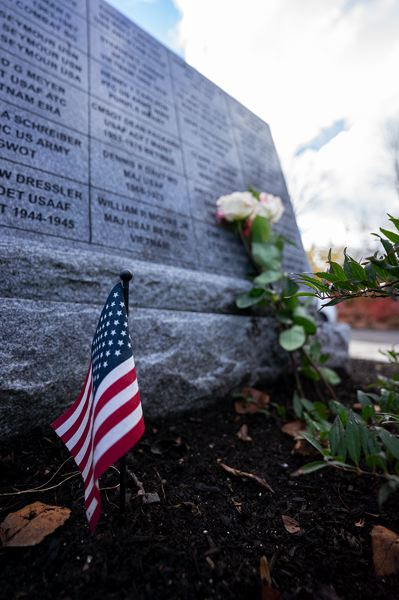 PMG PHOTO: CLARA HOWELL  - People left fresh flowers near the memorial wall at Foothills Park on Veterans Day.